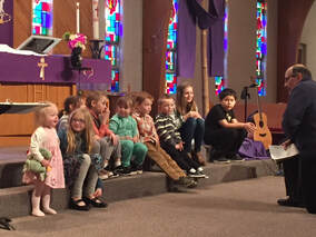 Attentive children listening to Pastor during children's message